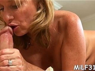 Rubbin' grease on her yam-sized bra-stuffers makes babe highly lewd