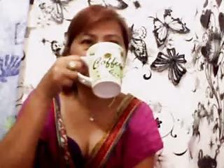 manila granny drinkin coffee