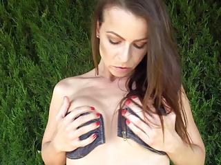 Housewife fingering her mature cunt in the garden