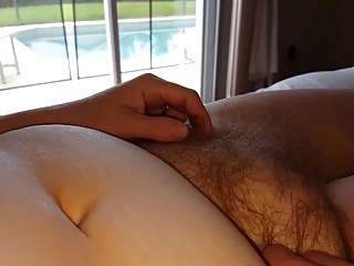 running her fingers through her own soft hairy bush