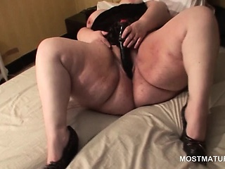 Mature BBW in lingerie masturbates with dildo