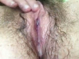 My hairy wife rubs her twat to orgasm and tries squirting