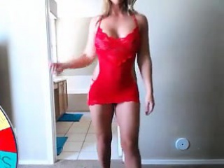 Sultry blonde mom in red puts the superb curves of her body