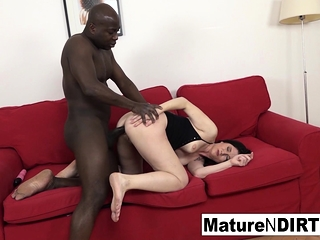 Mature takes a big black cock up her rump until it's packed with spunk!