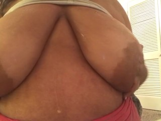 Plus-size toying with thick boobs before sofa