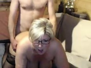 Horny blonde plumper with glasses sucks and fucks a cock on