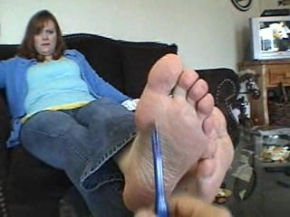 Mature woman shows off feet in white crew socks