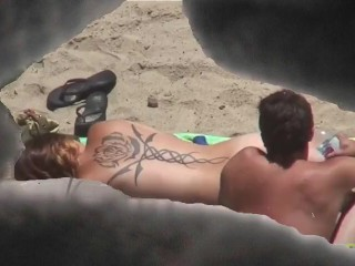 Naturists absolute Couples round an obstacle seashore