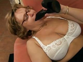 Busty granny gets orgasm