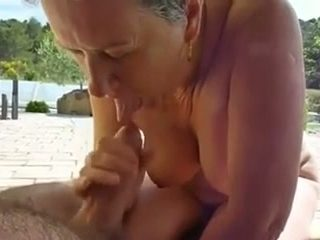 Busty mature woman sucking my cock balls deep right on a beach