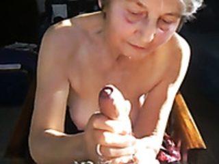 Kinky granny with saggy boobs gives me some handjob