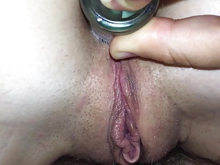 Inserting mini-bar bottle into wife's ass whilst fucking