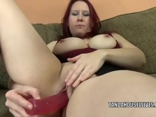 Redhead MILF Lia Shayde uses a dong to pleasure her pussy