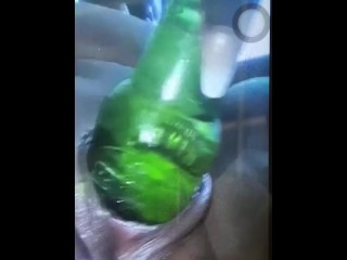 Ebony cunny drank beer bottle.