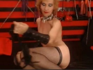 Old webcam granny is playing with her big sex toy