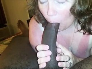 Housewife eating his lengthy black sausage