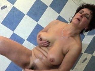 Naughty granny enjoys her body in the bathroom
