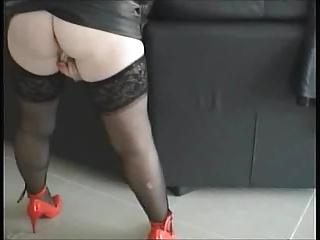 Sexylegs black leather mini skirt and her vibrator