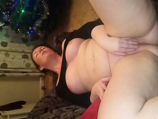 Shapely wife massaging against her moist pussy