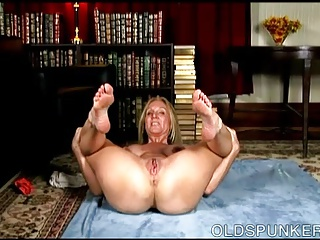 Lovely old spunker shows off her sexy yoga stretches