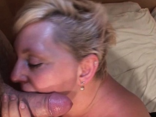 Chesty mature licks and sucks a tasty cock