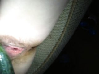 Horny and slutty wife poking her hairy vagina with cucumber