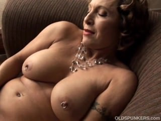 Tasty old spunker with a tight body plays with her juicy pussy