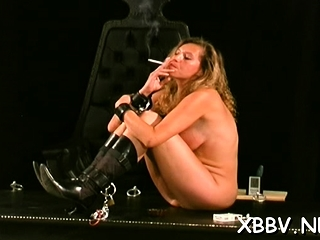 Nude lady stands and suffers tough sadism & masochism