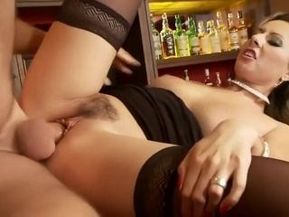 Platinum-blonde cougar torn up on a club table